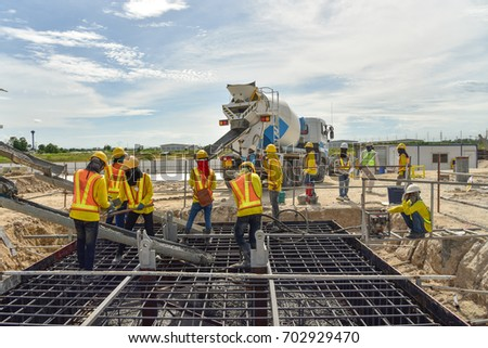 791eec65d3615 Construction worker Concrete pouring during commercial concreting floors of  building in construction site and Civil Engineer