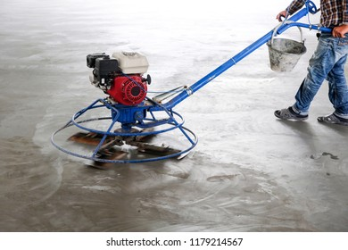 Construction worker are controlling Concrete Floor Grinding Machine.