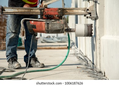 Construction worker coring concrete