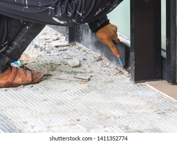 Construction worker destroying and repair floor by drill.The worker wear shoe unsafe may cause danger.