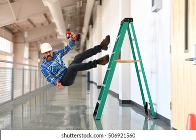 Construction worker falling off the ladder inside a building