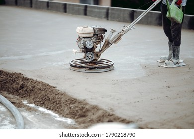 Construction worker finishing concrete screed with power trowel machine, helicopter concrete screed  finishing and smoothing