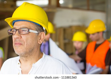 Construction worker in front of collegues.