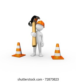 Construction worker with a hammer and traffic cones