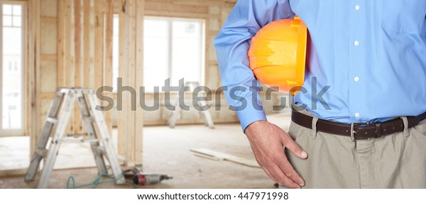 Construction worker with helmet.