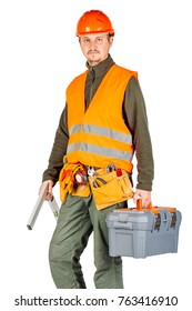 construction worker in a helmet  with toolbox and looking at camera over white wall background. repair, construction, building, people and maintenance concept.