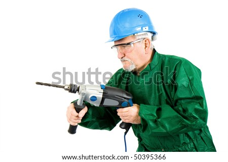 Construction worker holding the electric hand drill