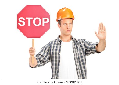 Construction worker holding a stop sign isolated against white background
