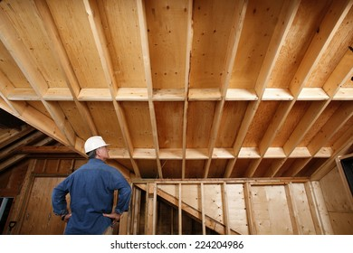 Construction worker inspecting home addition.