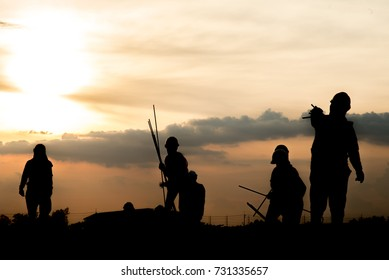 construction worker install steel rebar wall and concrete slab structure in construction site safety uniform during sunset background