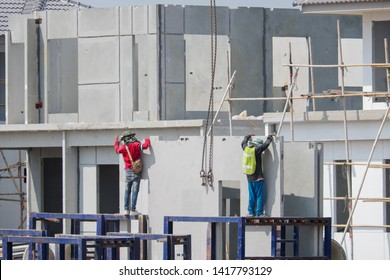 Construction worker are installing the precast concrete wall, worker with unprotected and unsafe.