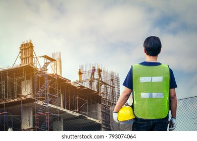 Construction worker or male architect at a building site