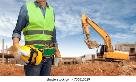 a construction worker man with all of tools supplies and articulated wheel crawler loader ready for check and building inspection at the engineer site construct buildings