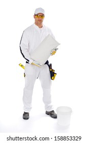 Construction worker mixing tile adhesive