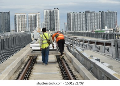construction worker  move equipment material railway on the track.team labour man bring concrete work on railroad transportation machine of infastructure  in city.