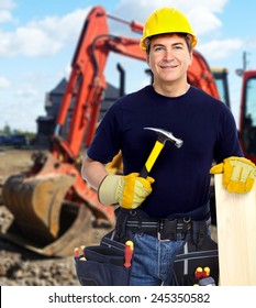 Construction worker near excavator. Home renovation background