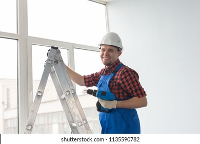 Construction worker in new house. Renovation concept