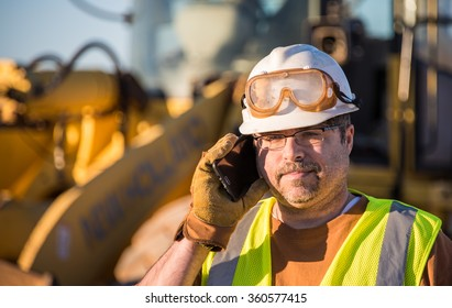 Construction Worker on Cell Phone Looking Down