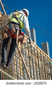 A construction worker on a high wall