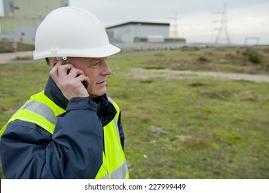 Construction Worker On Telephone