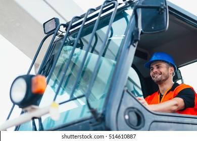 Construction worker operating on Skid Steer Loader