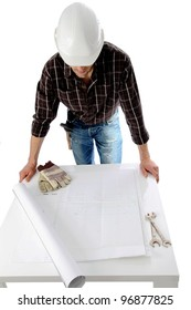 Construction worker over plan roll on a table
