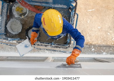 Construction worker plastering external wall work