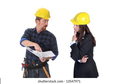 construction worker pointing on architectural plans and architect