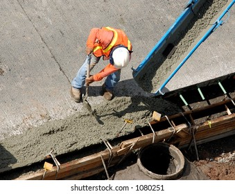 Construction worker pour cement for sidewalk in Honolulu Hawaii.