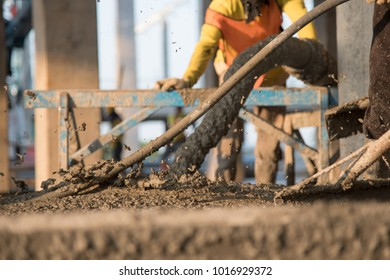 construction worker pouring concrete in construction site