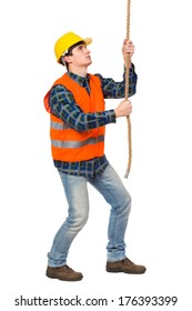 Construction worker pulling a rope. Full length studio shot isolated on white.