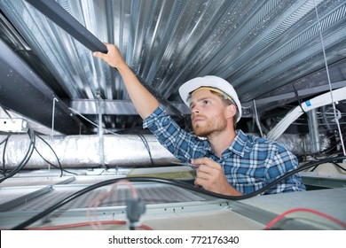 construction worker removing steel beam on the ceiling