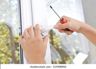 Construction worker repairing window handle