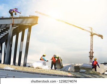 construction worker to roofing on high places of large building in construction site