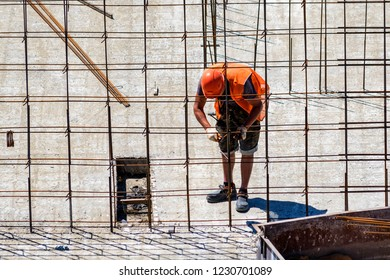 Construction worker in safety helmet at residential building construction site