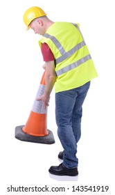 Construction worker setting out a traffic cone  isolated on white