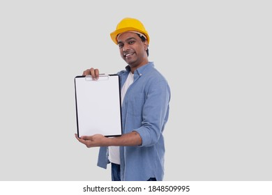 Construction Worker Showing Clipboard Wearing Yellow HardHat. Isolated