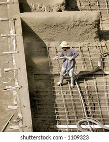 Construction worker spraying cement in Honolulu Hawaii.