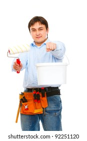 Construction worker stretching paint bucket and brush