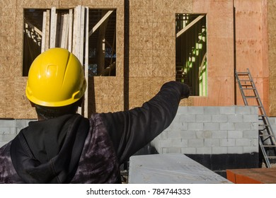 construction worker supervising building construction