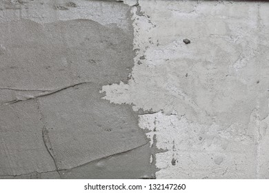 Construction worker is tiling at home, tile floor adhesive Abstract plaster stucco wall