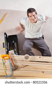 A construction worker with tools and wood