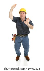 Construction worker trapped in imaginary box.  Full body isolated on white.