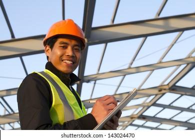 Construction worker under new building