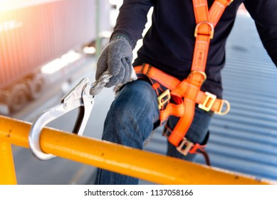 Construction worker use safety harness and safety line working on a new construction site project.Harness is a equipment for safety in construction site.