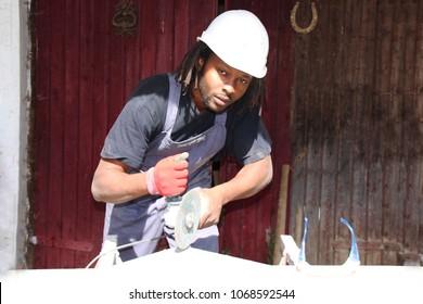 A construction worker using a Power cut Machine