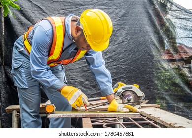 Construction worker are using tape measurements to measure planks and pencil are used to write, Close up of male hands measuring wood flooring, Construction industry, housework do it yourself.