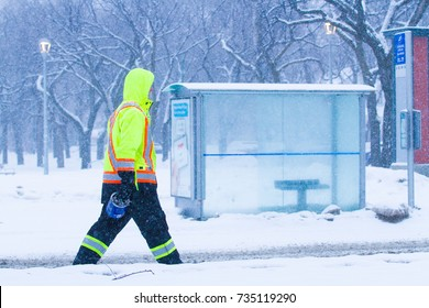 Construction worker walking to job site in snow