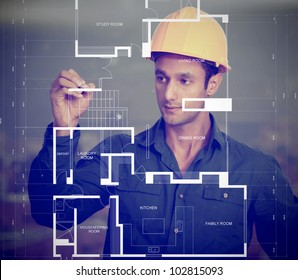 Construction worker wearing a helmet and sketching blueprints