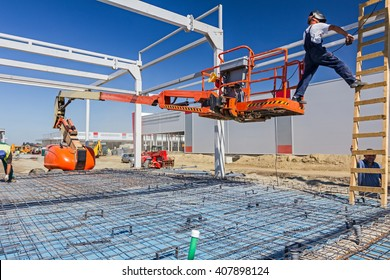 "Construction worker is welding metal frame without proper safety equipment on wooden leaders. Shopping center ""AVIV PARK"" in Zrenjanin, Vojvodina, Serbia, 01.08.2015."